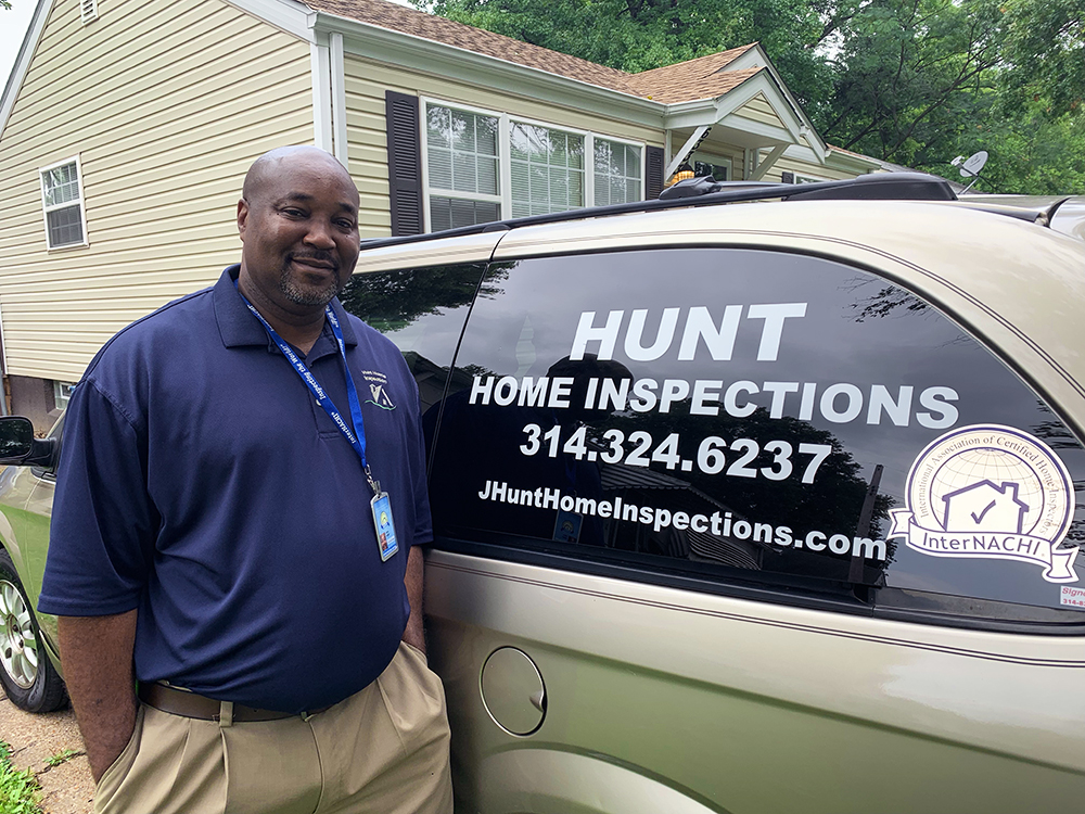 InterNACHI Certified Home Inspectors John Hunt next to his van
